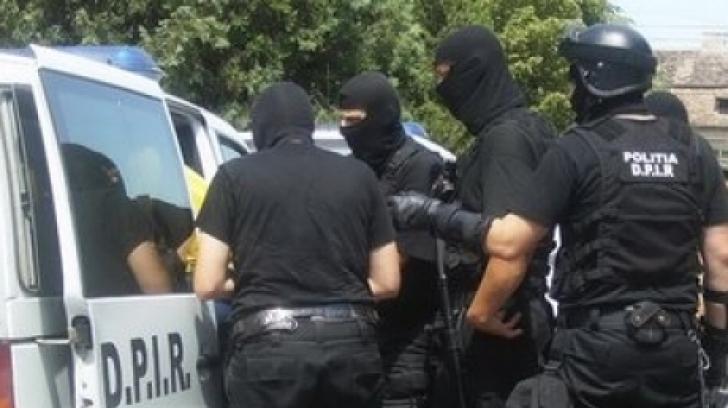Sătmăreni acuzați de spălarea de bani proveniți din exploatarea unor moldoveni, percheziționați de DIICOT